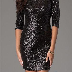 Ruby Rox sequenced black body con sleeved dress!